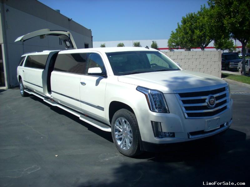 White Cadillac Escalade American Eagle Limo